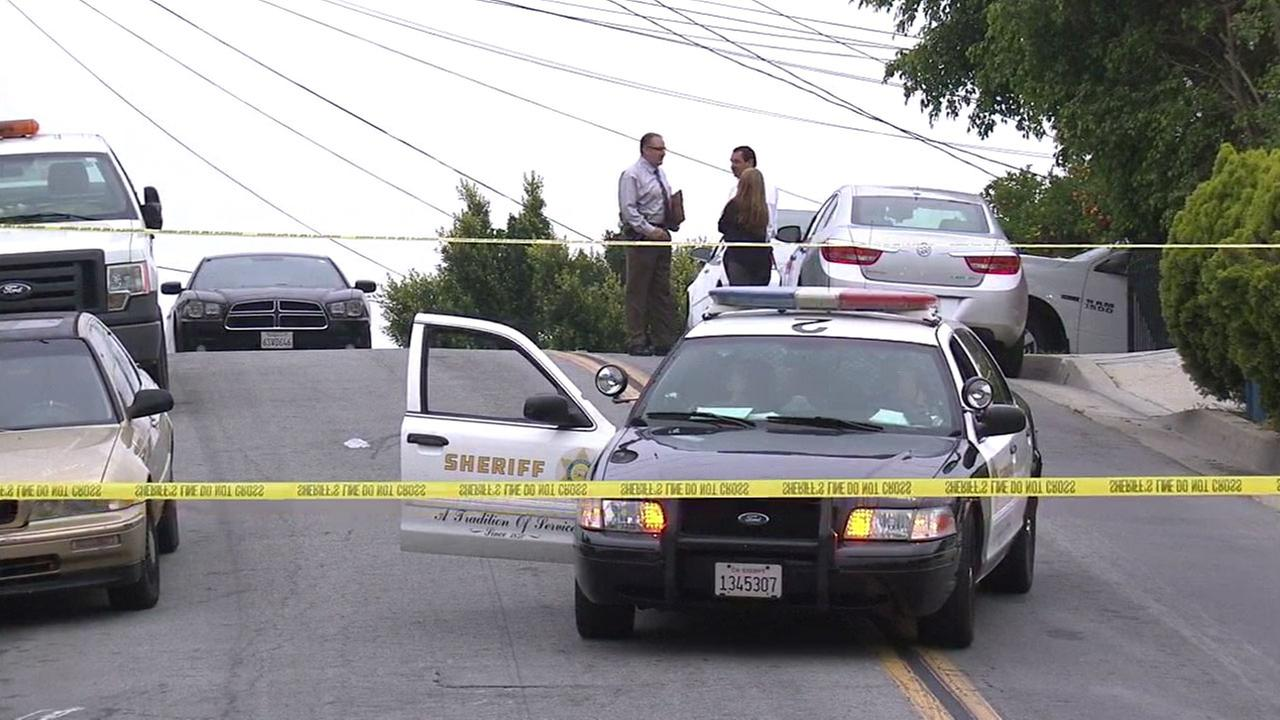 Authorities blocked off a section of road in East Los Angeles after a man is suspected of hitting a woman with a hammer on Wednesday, June 1, 2016.