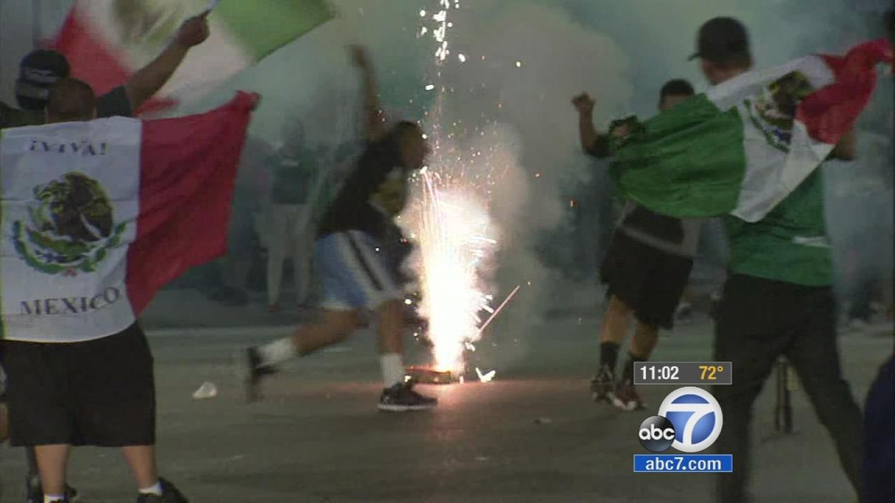 Hundreds of unruly fans hit the streets to celebrate following Mexicos advancing to the second round of the World Cup Monday, June 23, 2014.