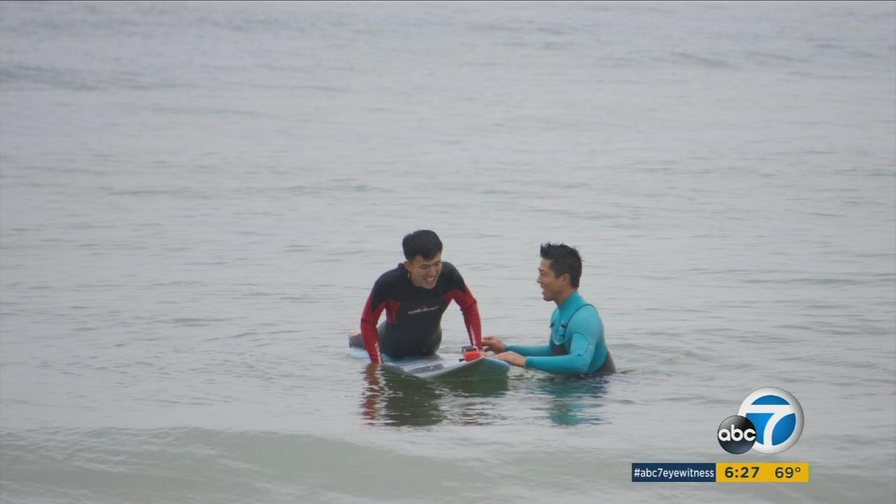 Lamberto Lo of Irvine had the rare opportunity to visit North Korea for 10 days to teach surfing