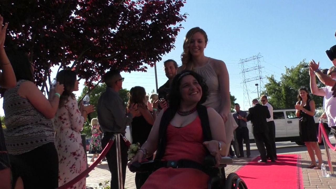 Students with special needs walk down the red carpet to attend an exclusive prom in Valencia.