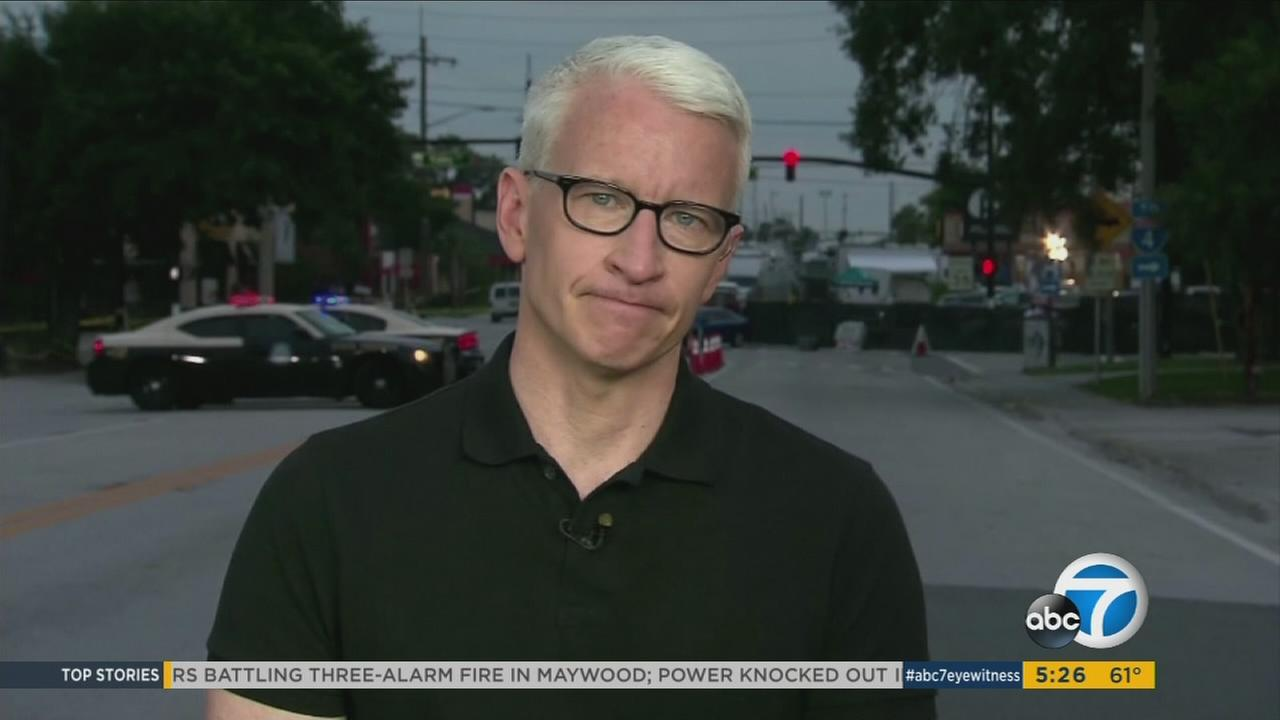 Anderson Cooper is seen fighting back tears as he reads the names of the victims killed in the Orlando nightclub shooting.