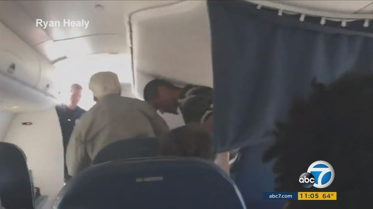 A man was escorted off a plane heading to Los Angeles International Airport after authorities reported a mid-flight verbal disturbance on Wednesday, June 22, 2016.
