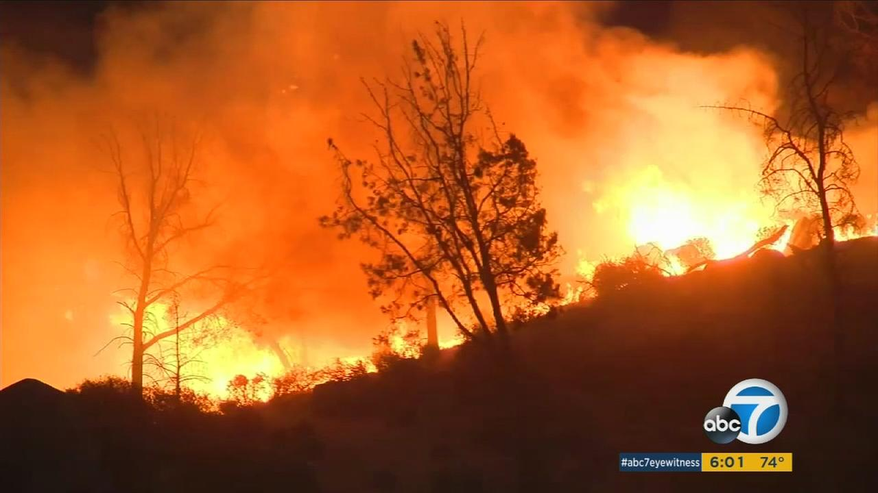 Two people have died in a fast-moving wildfire near Lake Isabella in Kern County. The blaze has charred 30,000 acres, destroyed 100 structures and forced hundreds of evacuations.