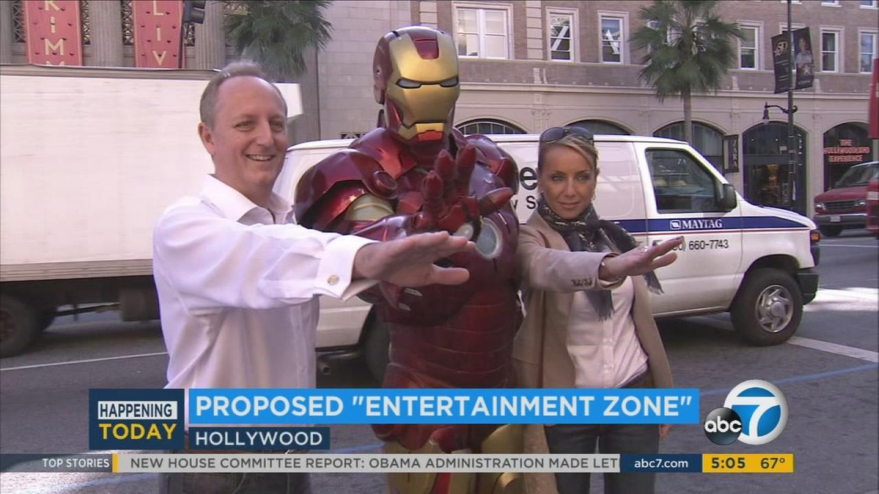 A costumed Iron Man takes photos with a family along Hollywood Boulevard in an undated photo.