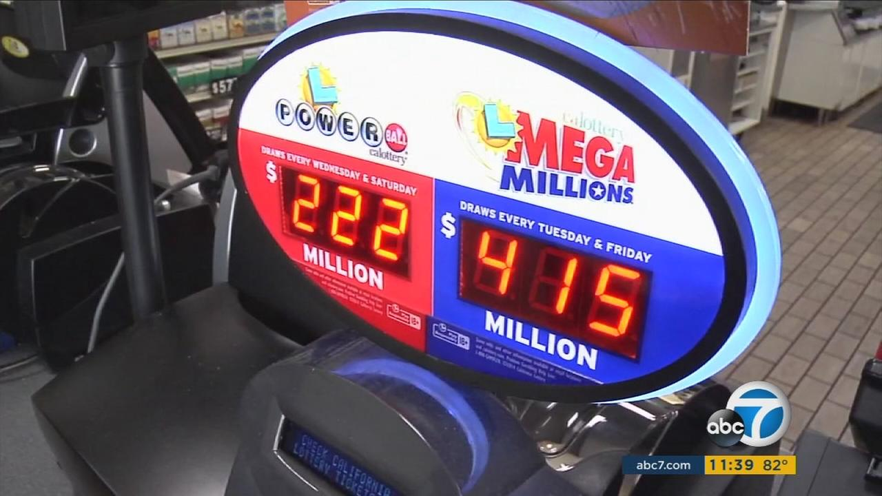 An electronic board shows the jackpot amount for the Mega Millions lottery which is at $415 million.