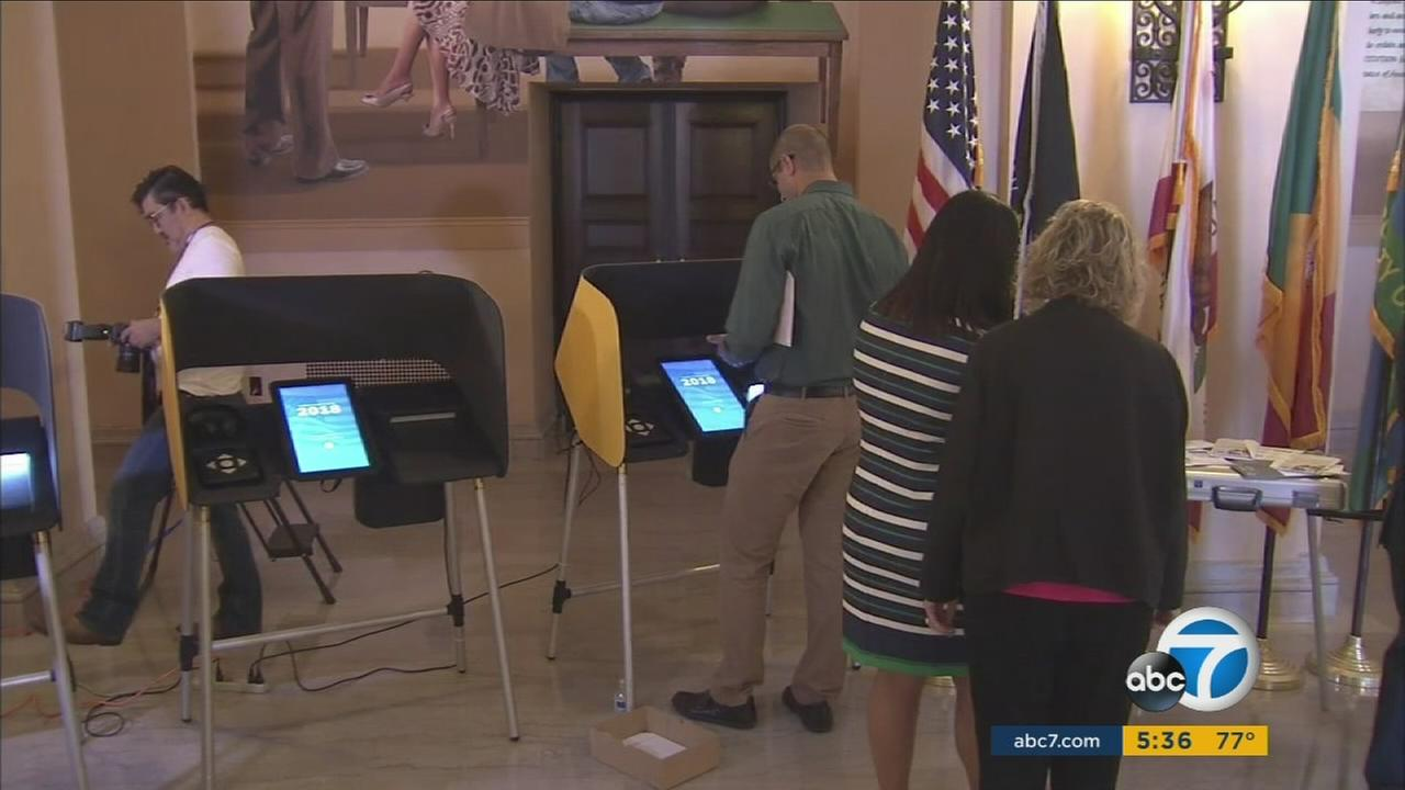 People seen voting using a new digital system in Los Angeles County in this undated photo.