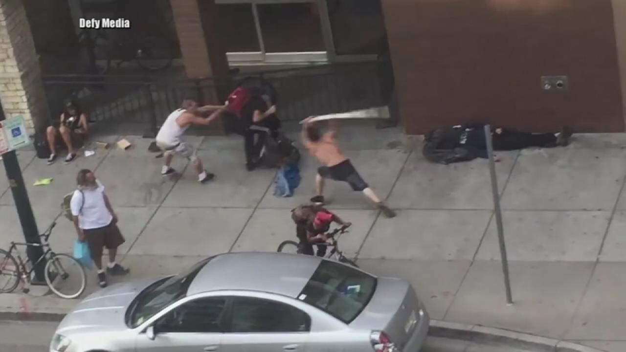 A homeless man is caught on camera attacking several bystanders with a large pipe in Denver.
