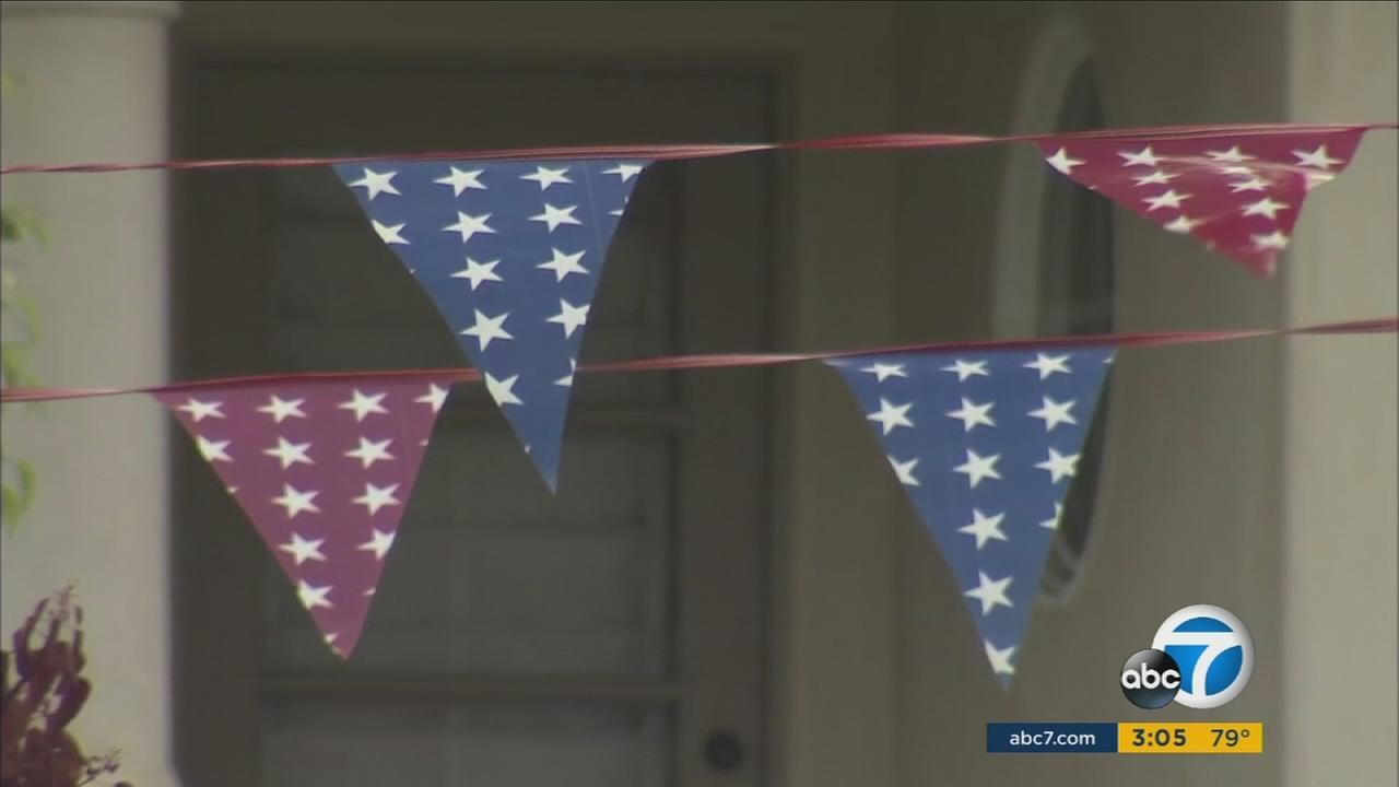 After someone complained, the city of Newport Beach is ordering Balboa Island residents to take down July 4th-themed pennants.