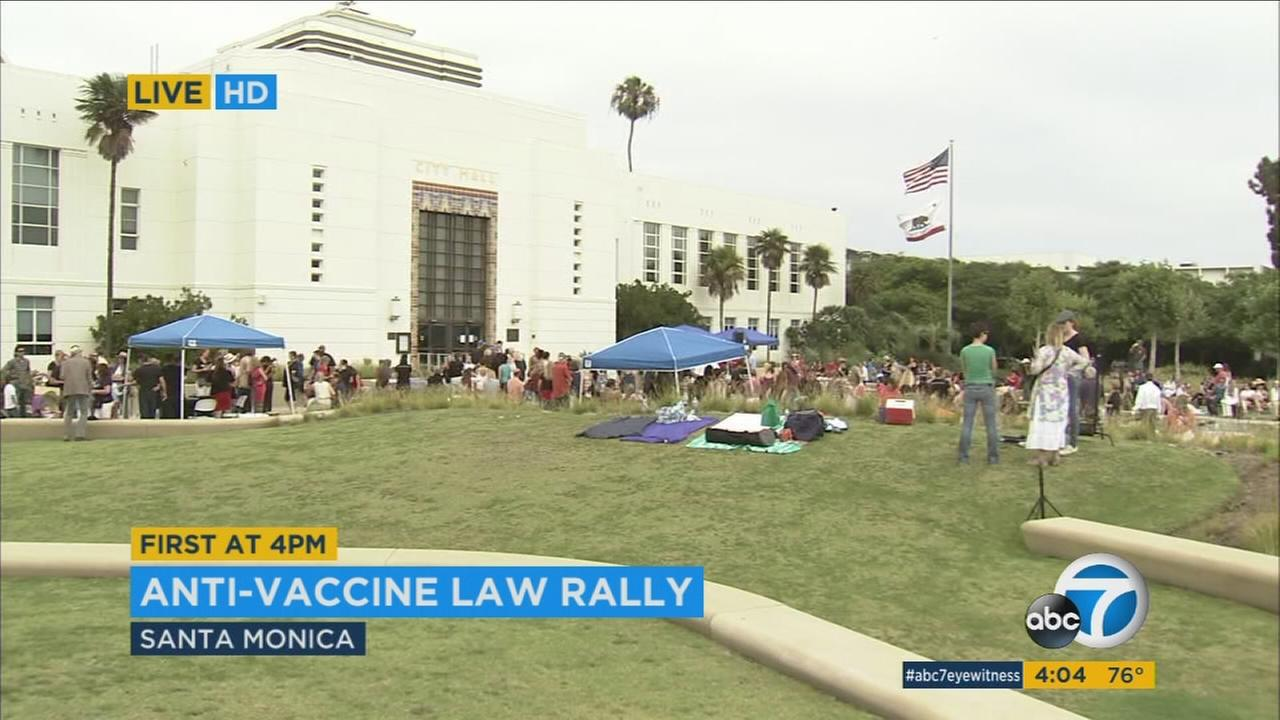 Some parents are rallying in opposition to a new California law that takes effect Friday requiring vaccines for children and blocking them from school if they do not comply.