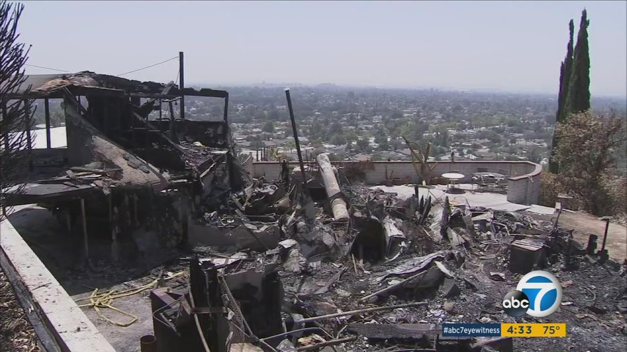 Officials are investigating an arson after several homes were destroyed in a San Bernardino brush fire over the Fourth of July weekend.