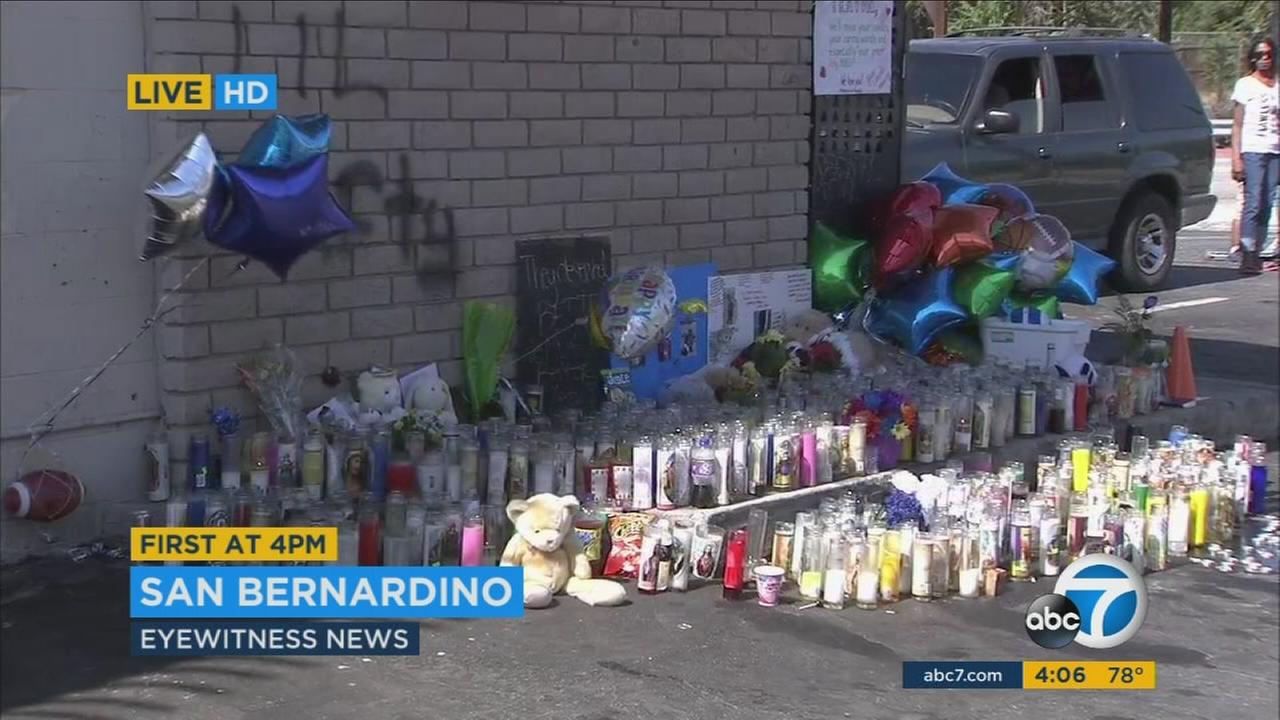 A memorial is growing outside a San Bernardino liquor store where three people were killed on Friday, July 8, 2016.