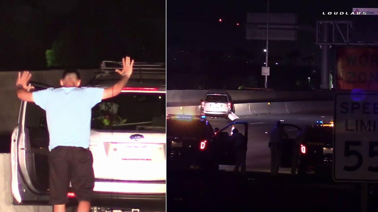 A chase suspect walks back toward police when he gave up after an hours-long standoff on the westbound 91 Freeway in Corona on Thursday, July 14, 2016.