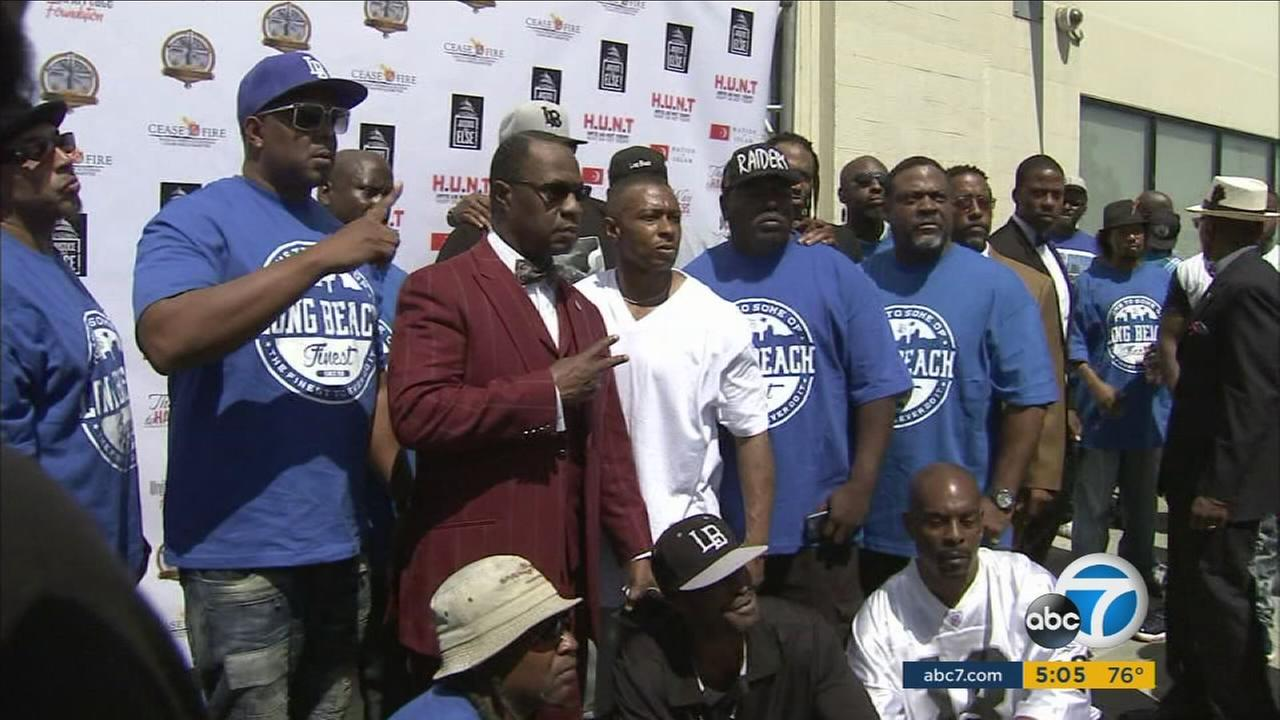 Members of the Nation of Islam pose for photos during an anti-gang summit they attended in South Los Angeles on Sunday, July 17, 2016.