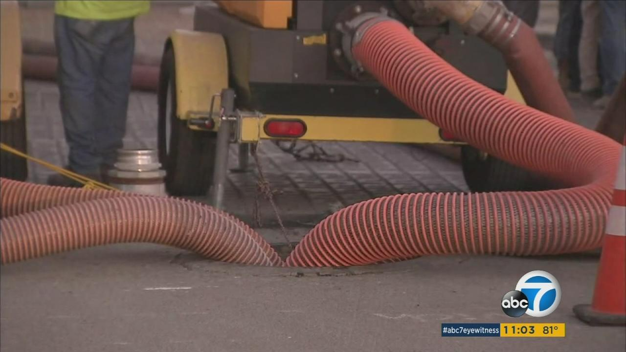 A sanitation machine works to clear out a blockage that caused a sewage pipe to collapse in downtown Los Angeles.