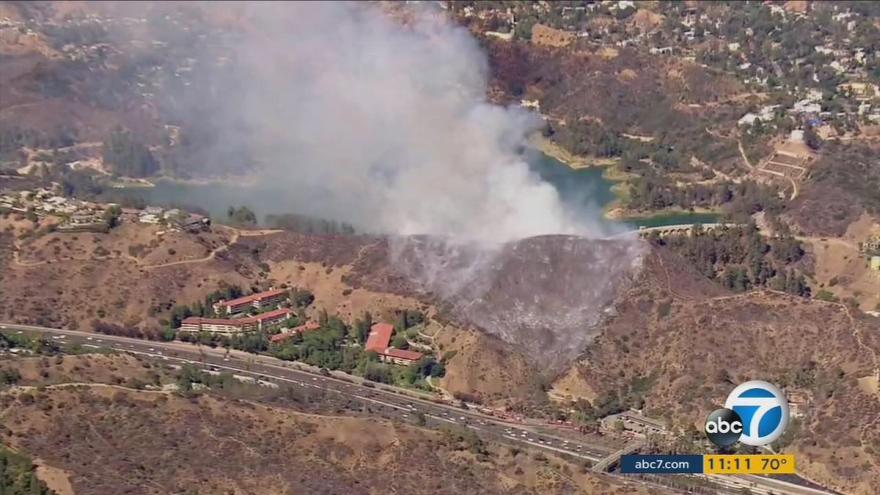 More than 200 firefighters battled a brush fire in the Hollywood Hills near the 101 Freeway on Tuesday, July 19, 2016.