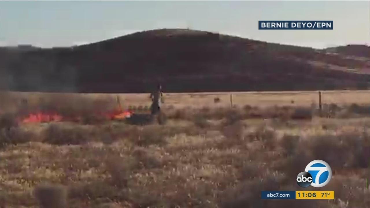 A suspected arsonist was caught on camera running around, setting off wildfires in the Gorman area.