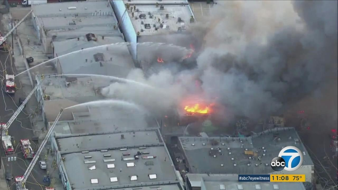 Firefighters battle a fire at a commercial building in downtown Los Angeles on Saturday, July 23, 2016.
