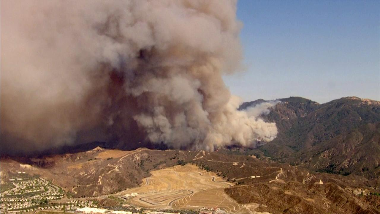 The Sand Fire in Santa Clarita has destroyed more than a dozen homes and scorched nearly 35 square miles.