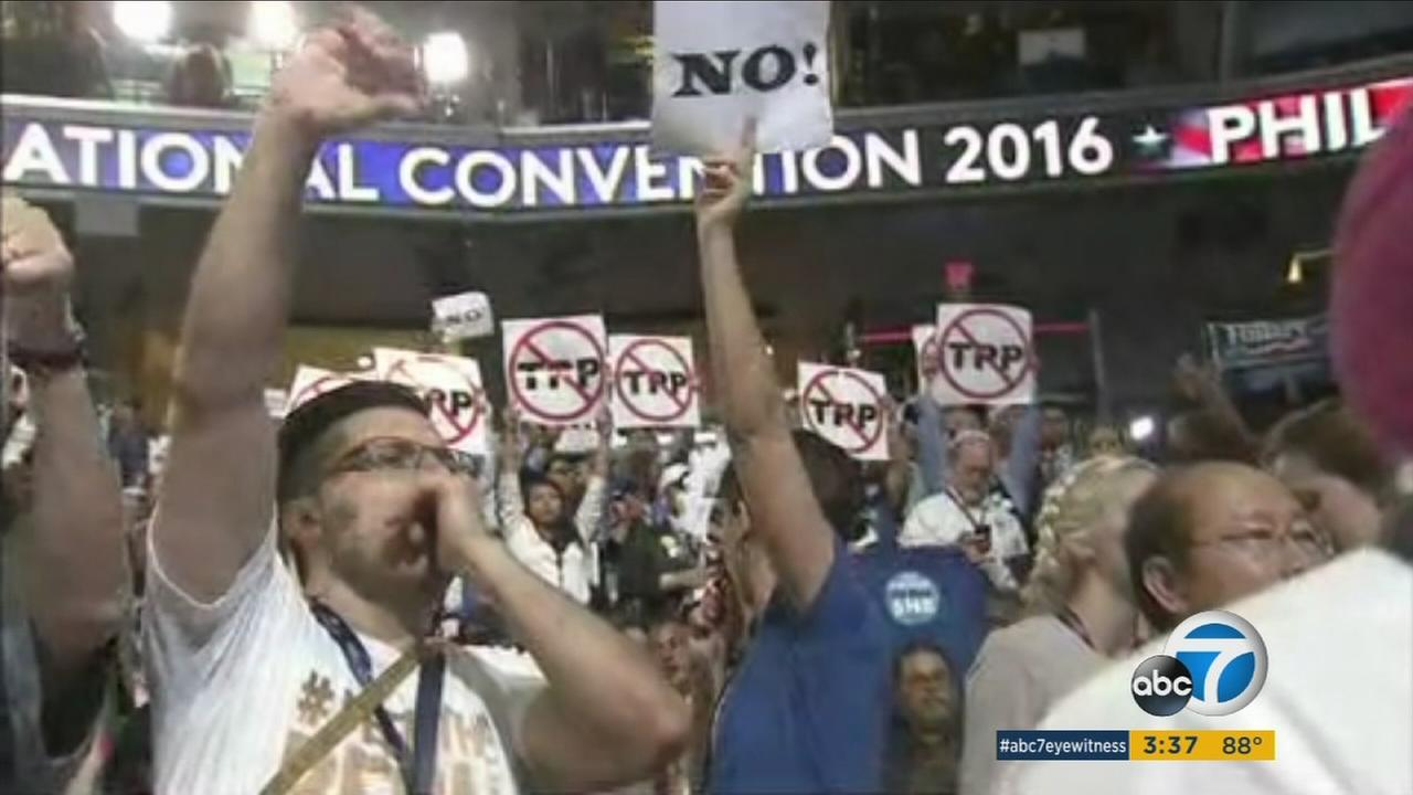 Signs of a divided party were apparent at the Democratic National Convention on Monday, as Bernie Sanders supporters loudly booed whenever Hillary Clintons name was mentioned.