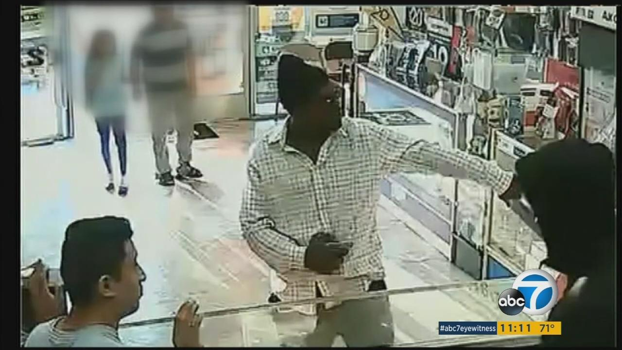 A robbery suspect is shown in a South Los Angeles cellphone store surveillance video on Tuesday, July 25, 2016.