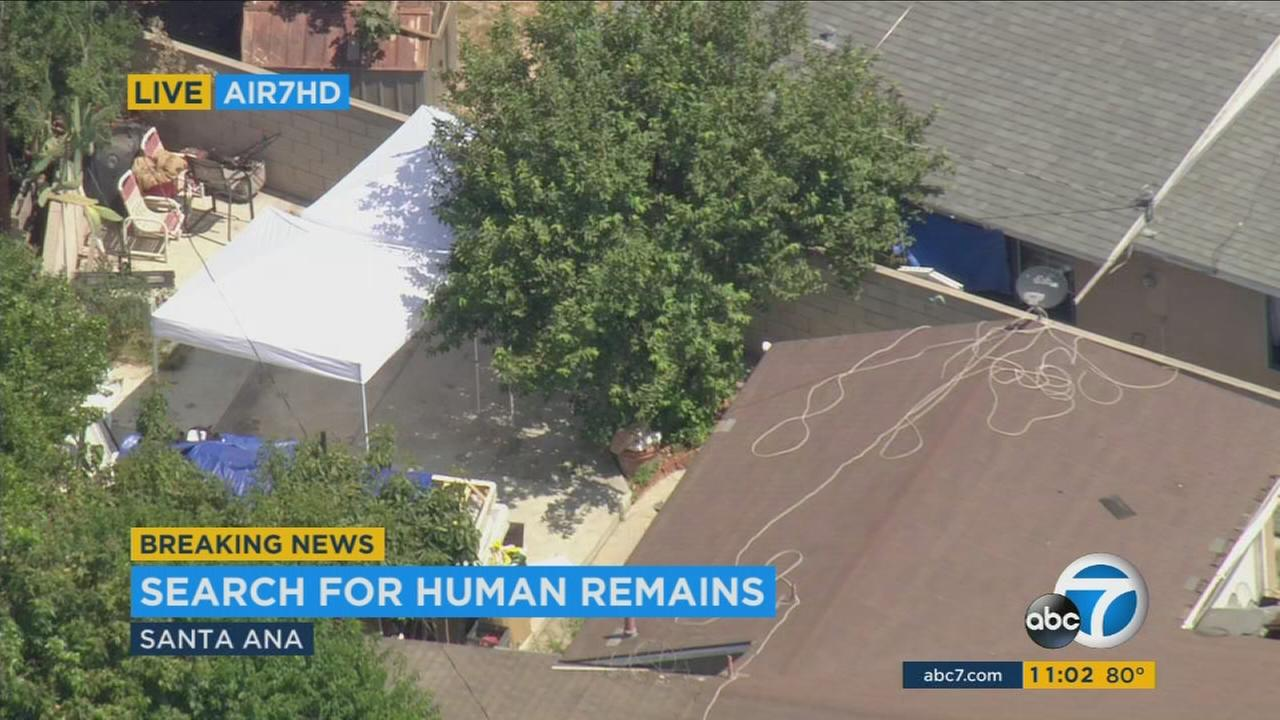 Investigators search for possible human remains in a Santa Ana backyard on Thursday, July 28, 2016.