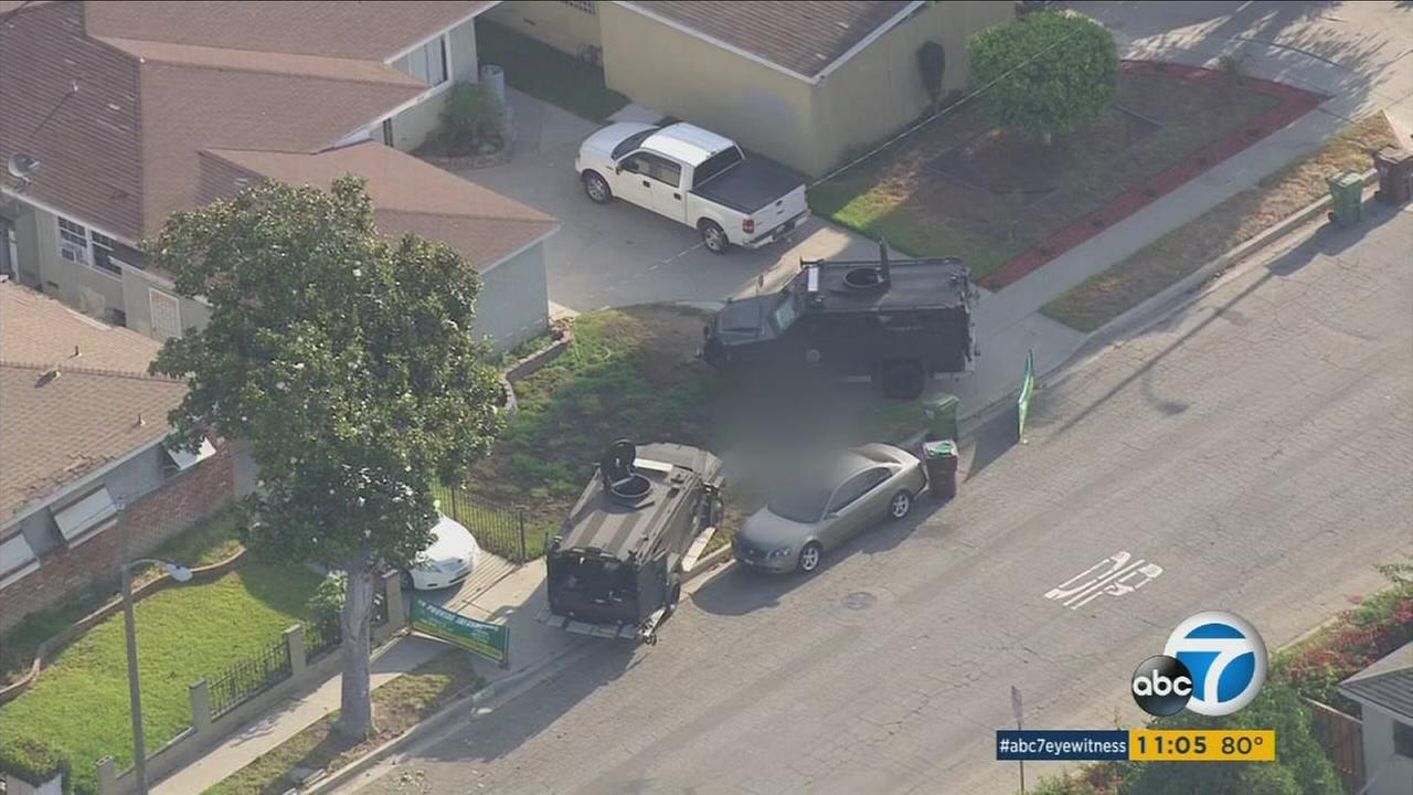 SWAT vehicles are shown in a Compton neighborhood where a man was fatally shot by sheriffs deputies on Thursday, July 28, 2016.