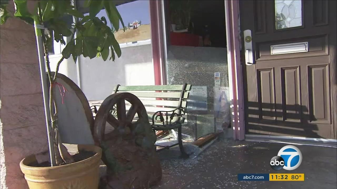 The smashed windows at a family-owned restaurant are shown on Thursday, July 28, 2016.
