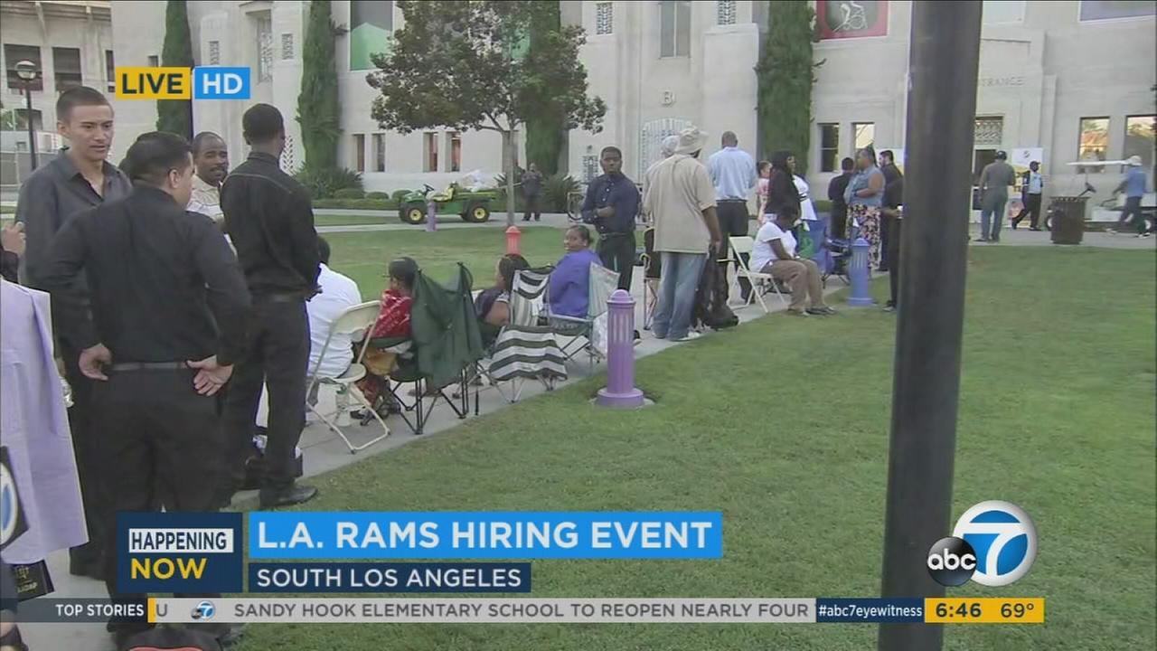 Southern California residents line up on Friday, July 29, 2016, at a hiring event to work with the Los Angeles Rams.