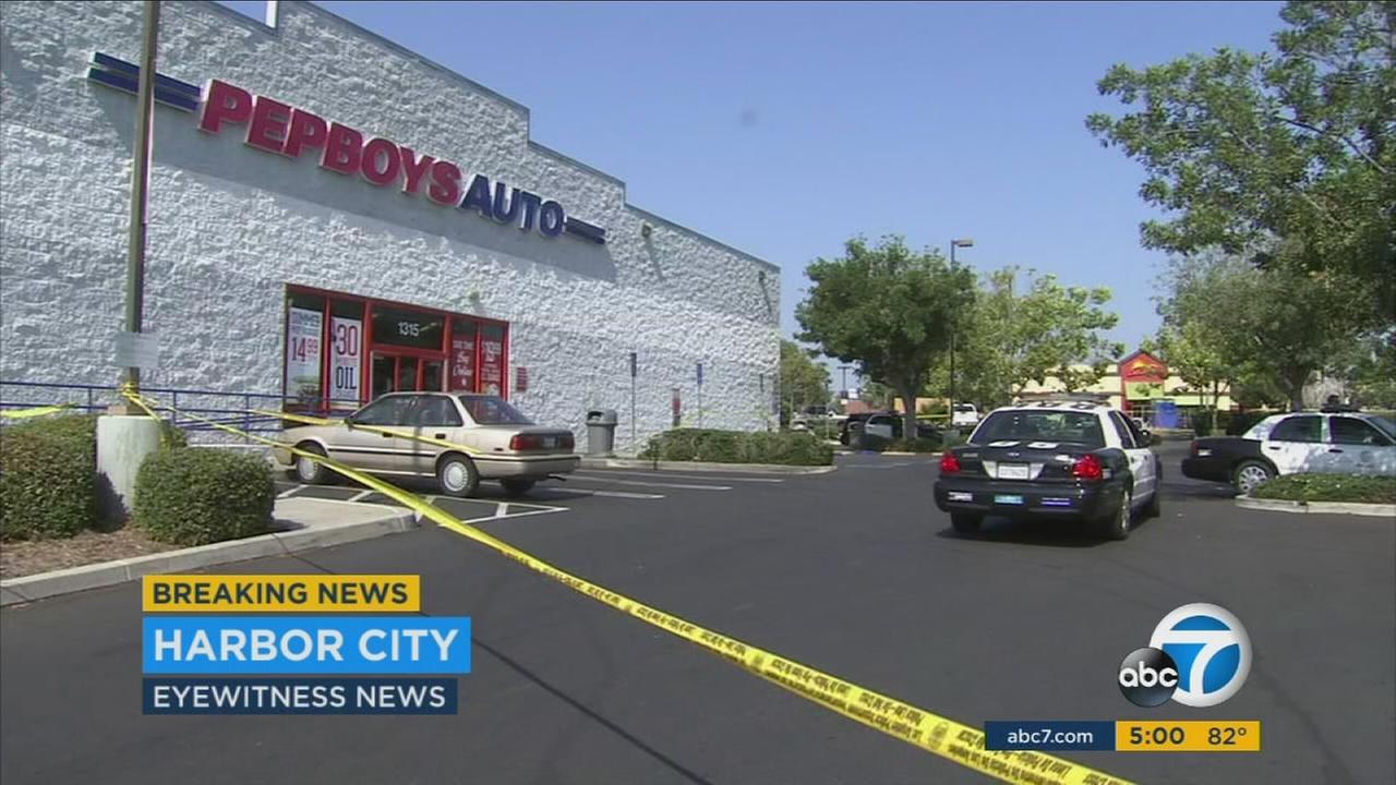 A woman was killed and a man was injured in a shooting at an outdoor barbecue stand near the Harbor City Pep Boys Friday afternoon.