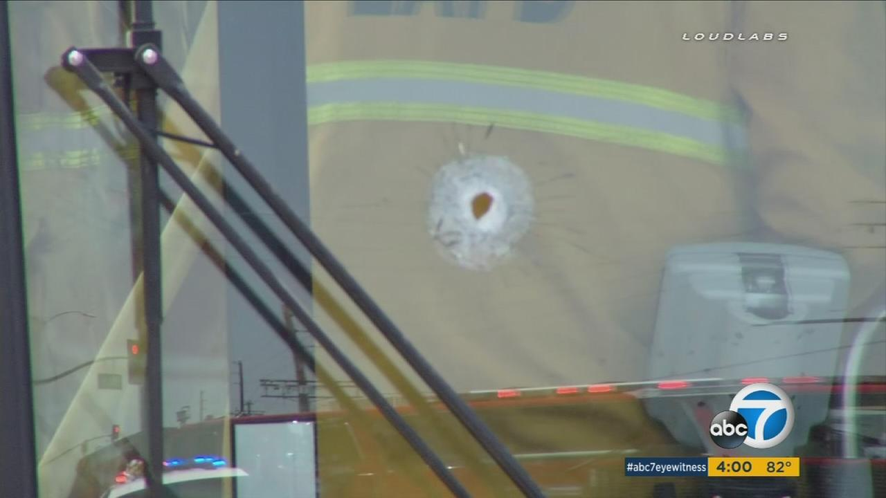 A bullet hole is shown on the front windshield of a Metro bus on Saturday, July 30, 2016.
