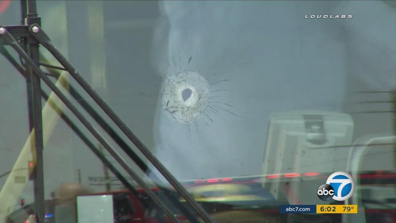 A bullet hole is in the front window of a Metro bus after a man opened fire on it on Saturday, July 30, 2016.