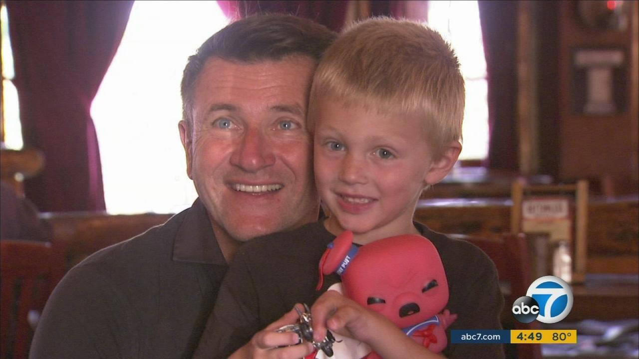 Shark Tank star Robert Herjavec poses for a photo with Liam Brenes during a party for the boy who had his prosthetic leg stolen stolen from an Orange County beach.