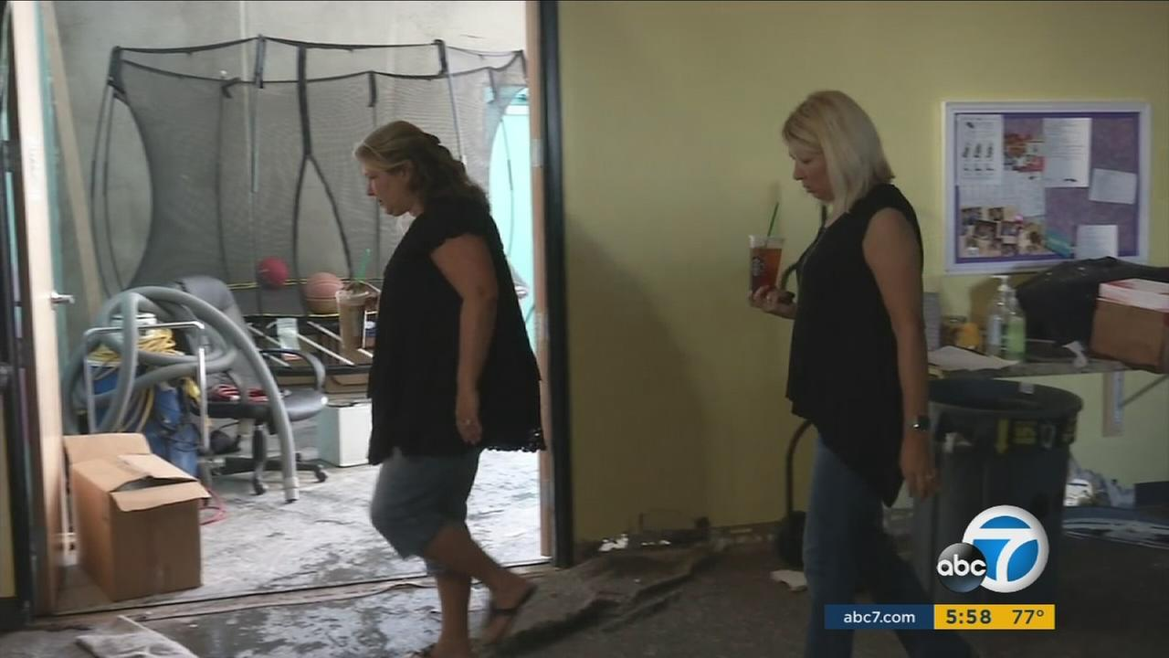 Stephanie Coe, left, and Michelle Dilts, co-founders of the aMAYZing Kids clinic, walked through the Lake Forest facility after a broken water main cause catastrophic damage.