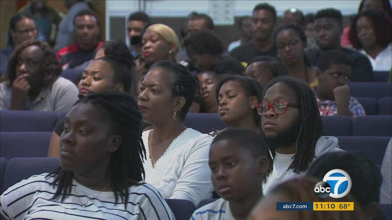 Compton residents sit at a community and law enforcement meeting to discuss how to keep the city safe after a string of shootings.