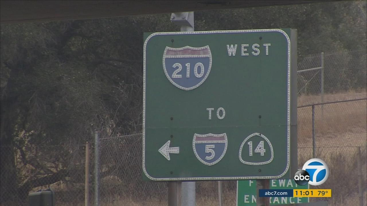 A 210 Freeway sign is shown in this photo.