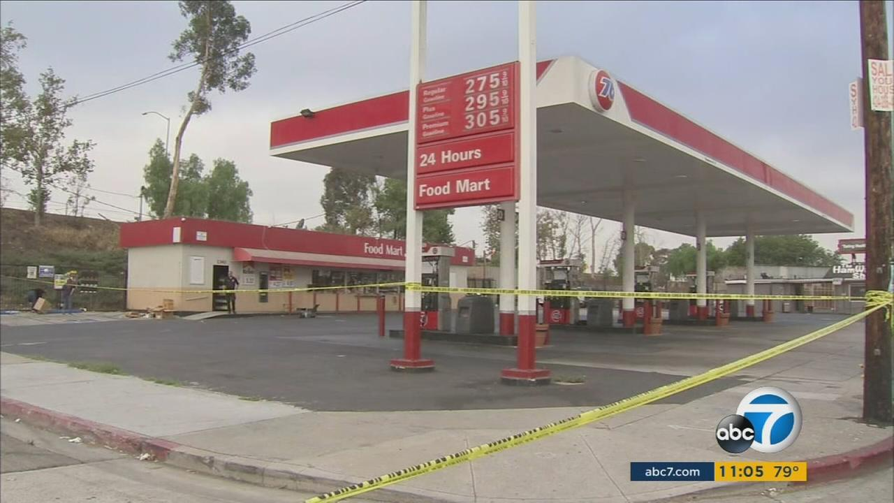Authorities blocked off a Watts gas station after one person was killed and two wounded in a gang-related shooting on Thursday, Aug. 4, 2016.