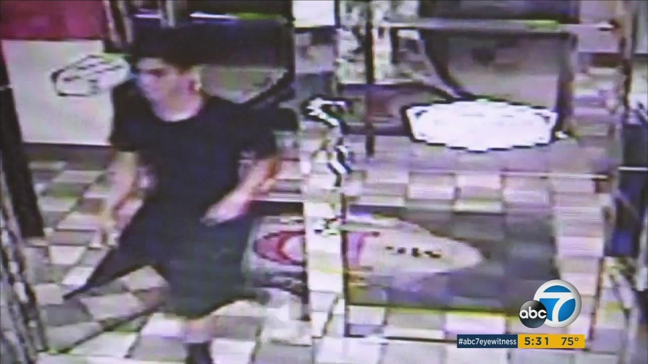 An arsonist was caught on camera using his pants to set a fire behind a diner in La Verne, according to police.