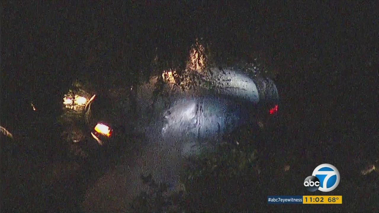 Police used hot gas and high-pressure foam to flush an armed suspect out of his car after he was spotted pointing a weapon at a home in La Verne, officials said.