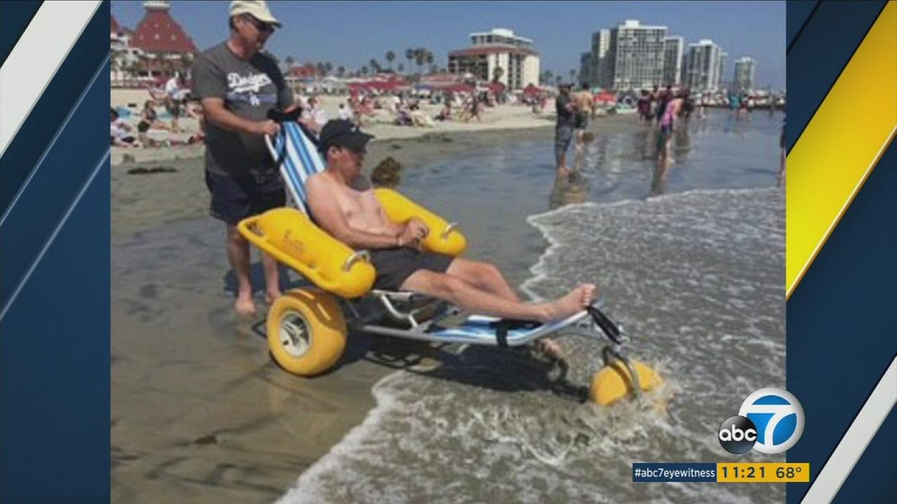 Mike Freeman is seen with his 26-year-old son Patrick and his special beach chair in this undated photo.