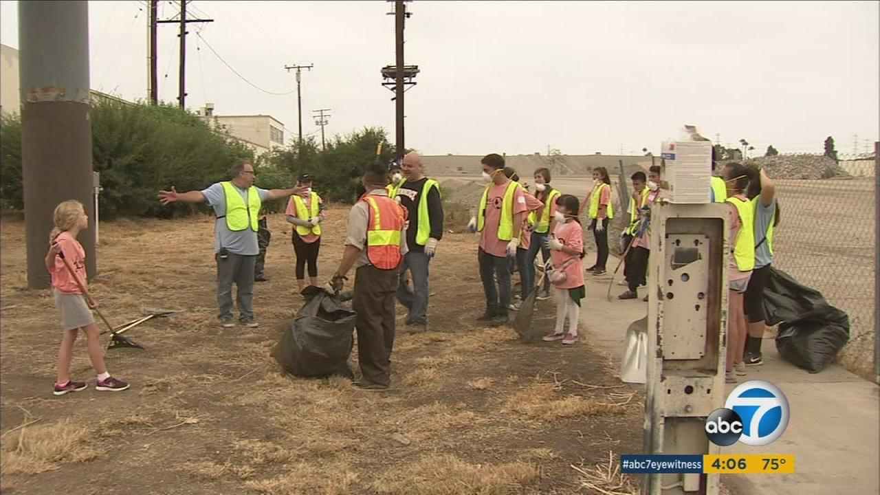 Hundreds of volunteers, including many teens, joined together to make a difference and took part in Clean Up Commerce.