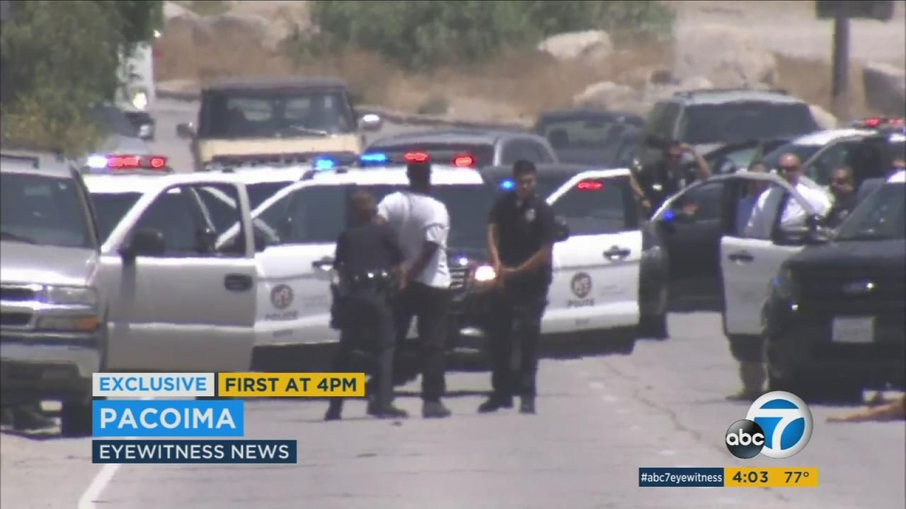 A suspect was taken into custody after a fatal shooting in Pacoima on Monday, Aug. 8, 2016.