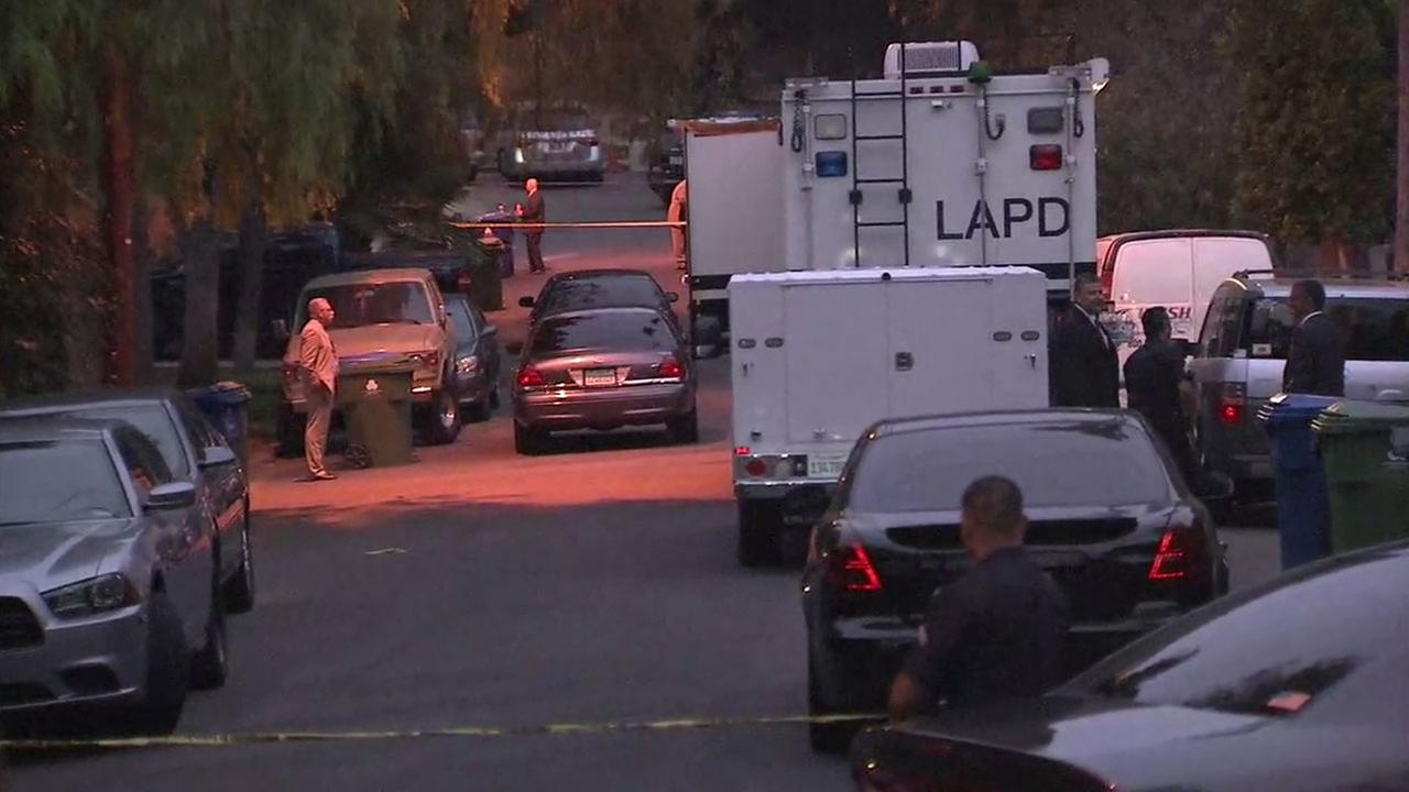 Authorities blocked off a street after a suspect was shot in an officer-involved shooting in Highland Park on Tuesday, Aug. 9, 2016.