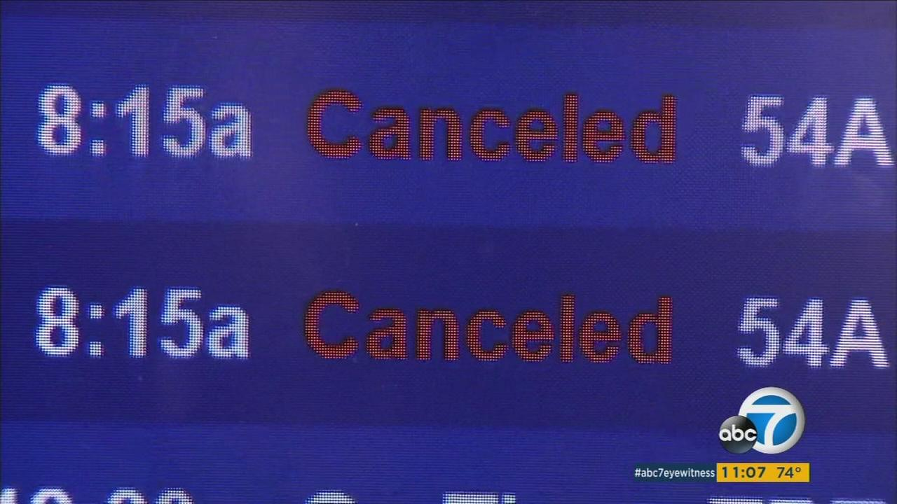 Signs at LAX show canceled Delta Airlines flights on Tuesday, Aug. 9, 2016.