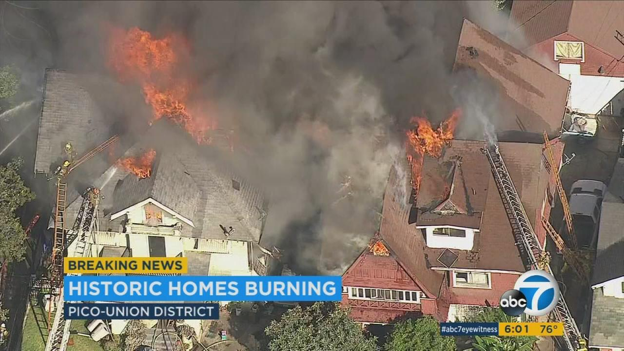 Two Craftsman-style houses and an apartment building in the Pico-Union district were badly damaged by flames and heavy smoke Wednesday afternoon, forcing the displacement of 41 people.