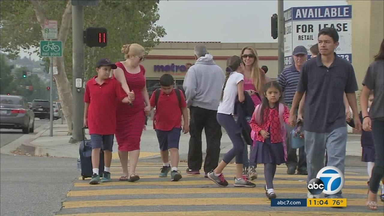 Parents walked with their children to school in Glendale. They were asked to be more vigilant after a suspect or suspects tried to abduct two kids on Wednesday, Aug. 10, 2016.