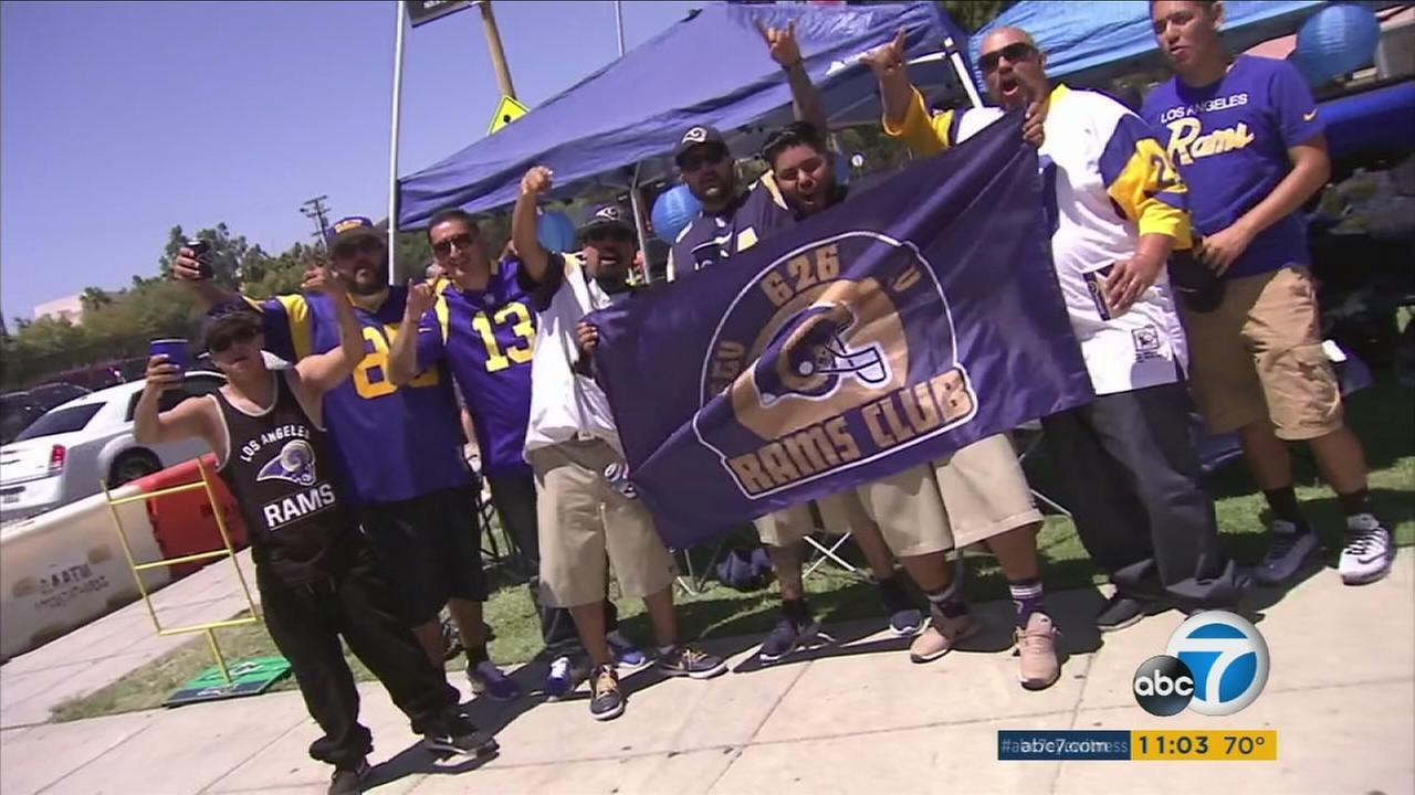 Rams fans are shown during a tailgating event in front of the L.A. Memorial Coliseum for the teams preseason opener on Saturday, Aug. 13, 2016.