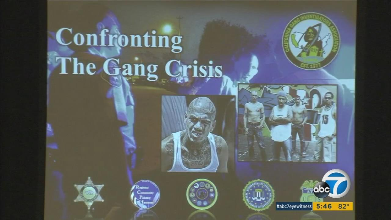 A slide shows how to combat gang violence in Orange County during a conference with law enforcement.