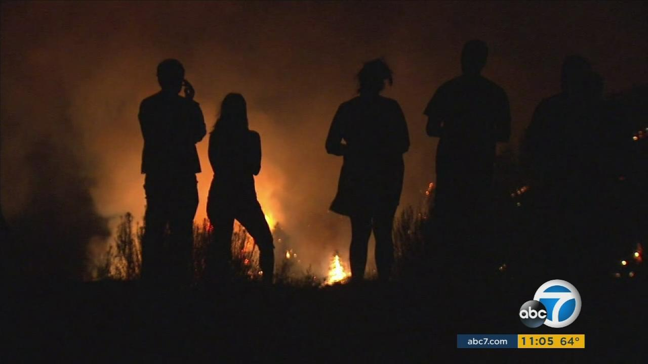 Some people are remaining in Wrightwood despite massive flames that have triggered mandatory evacuation orders.