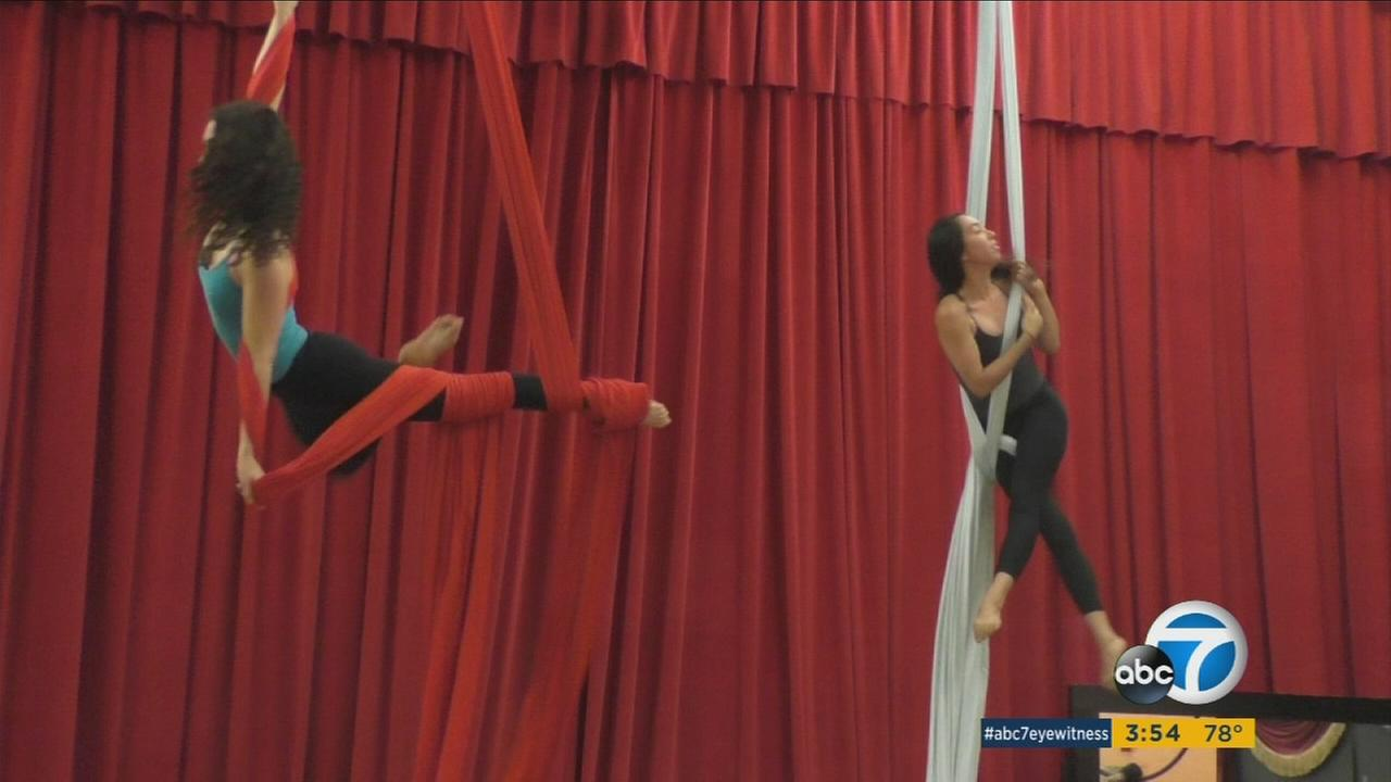 Aerial fitness enthusiasts should warm up with appropriate stretching and strength training to avoid injury during workout, according to expert.