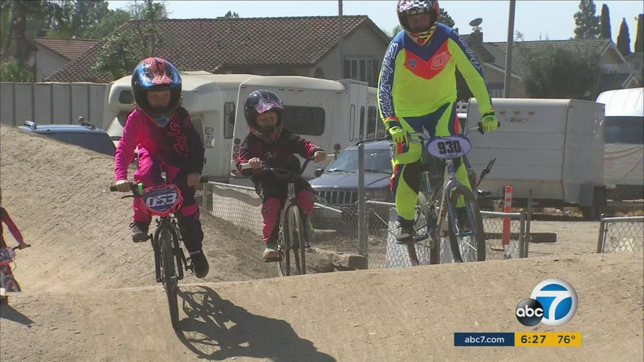 Kids are shown riding through a BMX track in Orange that faces closure after a lease deal did not go through.